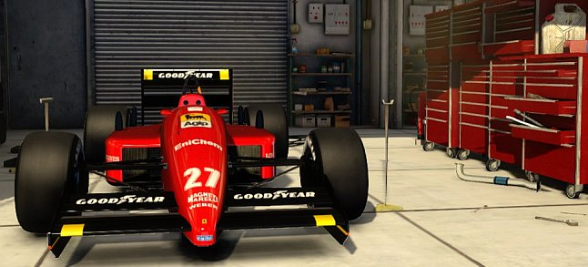 F1 2013 Ferrari F1-87/88C waiting in the pits.