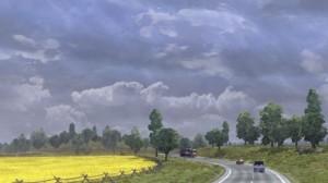 Euro Truck Sim 2 - driving through fields.